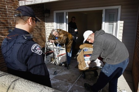 Harvey Lesser, 58, leans on his walker as an eviction team removes household belongings from his apartment after sheriff's deputies served him with a court eviction order on December 11, 2009 in Boulder, Colorado. Lesser, an unemployed software developer with chronic health problems related to obesity, said he stopped making rent payments after all of his savings were spent. Evictions and foreclosure rates nationwide soared in 2009, as millions of unemployed Americans were unable to pay the bills.